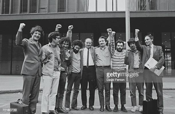 Portrait of the Chicago Seven and their lawyers as they raise their fists in unison outside the courthouse where they were on trial for conspiracy...