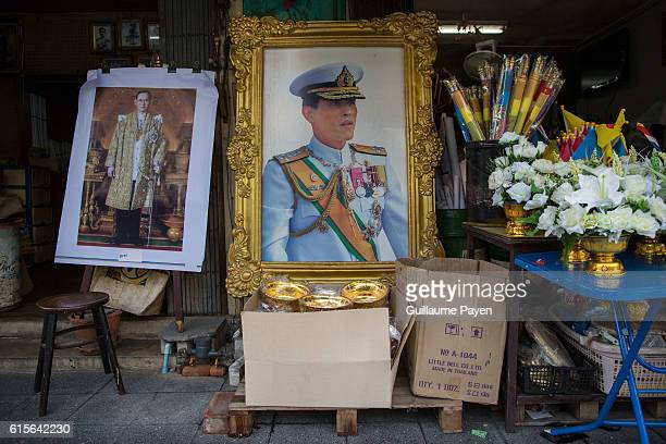 Portrait of the Crown Prince Maha Vajiralongkorn and an other of his father the late King Bhumibol Adulyadej are displayed at a shop that specialises...