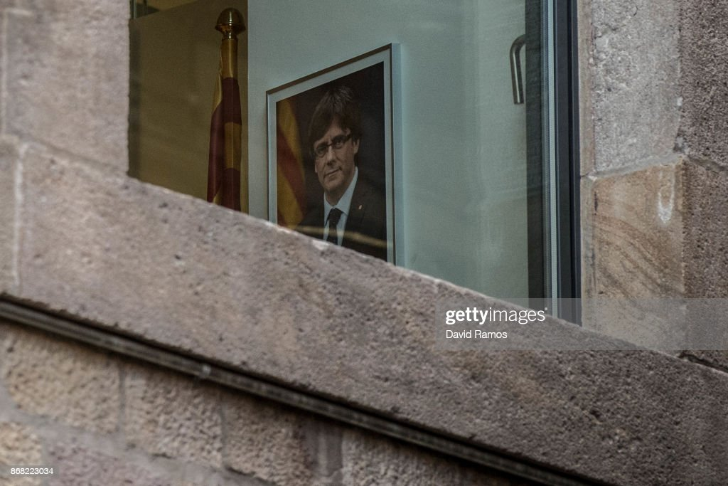 A portrait of the deposed President of Catalonia Carles Puigdemont hangs on a wall inside the Catalan Government building, Palau de la Generalitat, on October 30, 2017 in Barcelona, Spain. Carles Puigdemont and 5 five members of the government of Catalonia are in Brussels where they have held meetings with a number of Flemish politicians. The Spanish government has responsed by imposing direct rule, dissolving the Catalan parliament and calling for regional elections on Decemeber 21st.