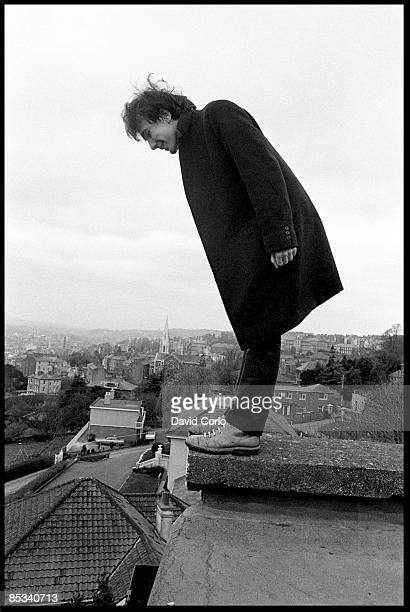 Portrait of The Edge of U2 looking over the edge of the roof of the Cork Country Club Hotel Cork Ireland March 2 1980