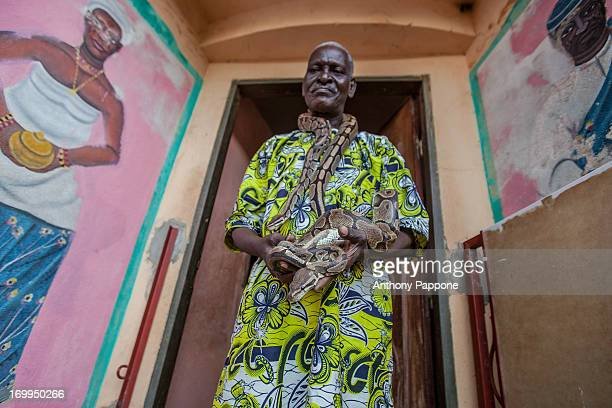 CONTENT] portrait of the fetish priest in the temple of pythons in Ouidah benin