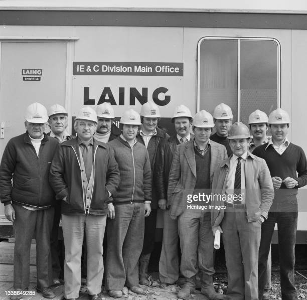 Portrait of the field supervisory team for the Alkylation Unit at Lindsey Oil Refinery, posed in front of the Laing IE & C main office. This image...