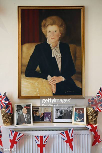 A portrait of the former British Prime Minister Baroness Margaret Thatcher hangs at the Finchley Conservative office on April 9 2013 in London...