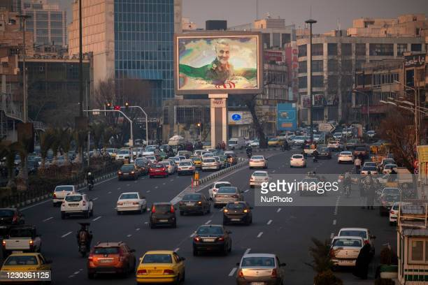 Portrait of the former commander of the Islamic Revolutionary Guard Corps Quds Force , General Qasem Soleimani, is seen on a giant screen on a corner...