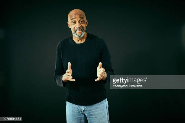 portrait of the gospel music composer who talking. - gesturing stock pictures, royalty-free photos & images