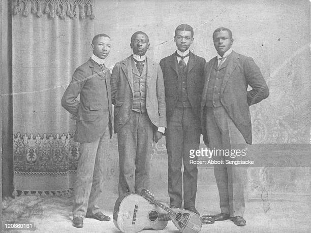 Portrait of the Hampton Quartet, among them American concert tenor and future newspaper publisher Robert Sengstacke Abbott , on the campus of the...