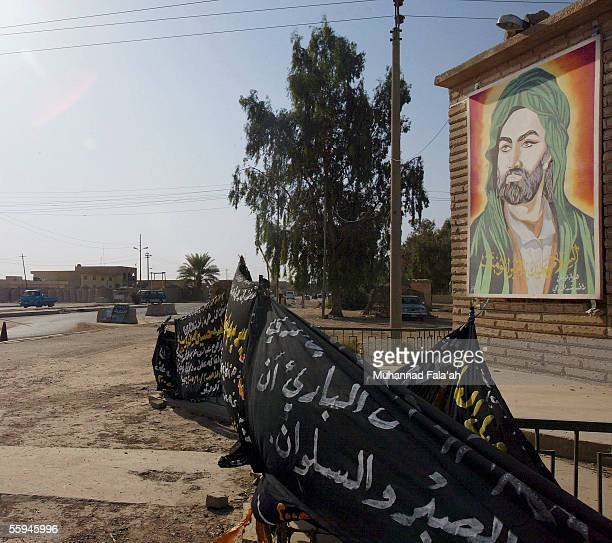 A portrait of the holy Shiite Imam Ali is seen at the entrance of the mostly Shiite town of Dujail on October 8 35 miles north of Baghdad Iraq On...