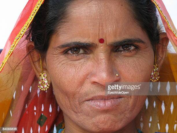 Portrait of the indian woman SENTOZ 32 years old with earrings a nosering and traditional bindi sticker on the forehead on January 06 2008 in Pushkar...