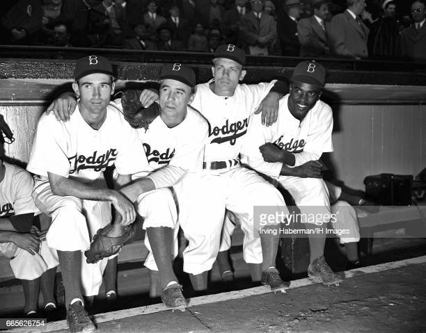 Portrait of the infield players from the Brooklyn Dodgers baseball team as they pose in the dugout during the season opener at Ebbets Field New York...