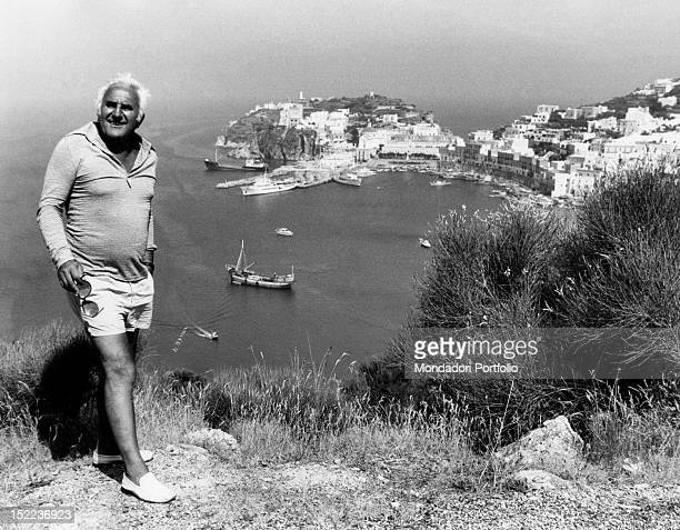 Portrait of the Italian actor scriptwriter and director Adolfo Celi In the background a panoramic view of Ponza Ponza 1970s