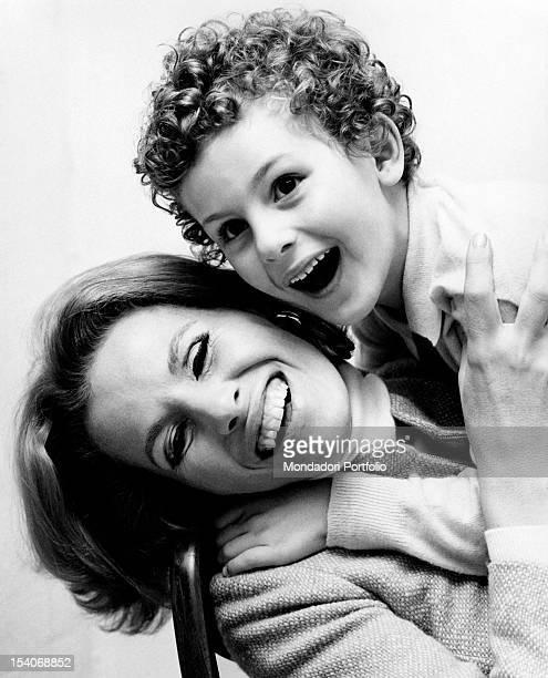 Portrait of the Italian actress and singer Ornella Vanoni smiling with her Italian son Cristiano Ardenzi Margherita di Savoia 1960s