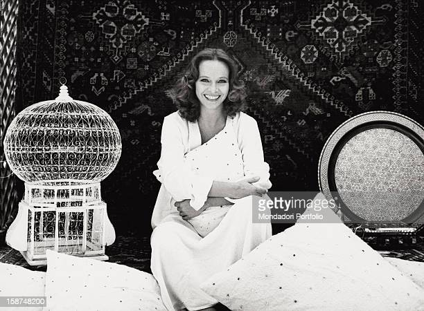 Portrait of the Italian actress Laura Antonelli sitting on the terrace of her house Rome 1979