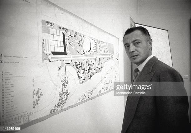 Portrait of the Italian entrepreneur and industrialist Gianni Agnelli in front of the plan of the International Labour Exhibition Turin 1961