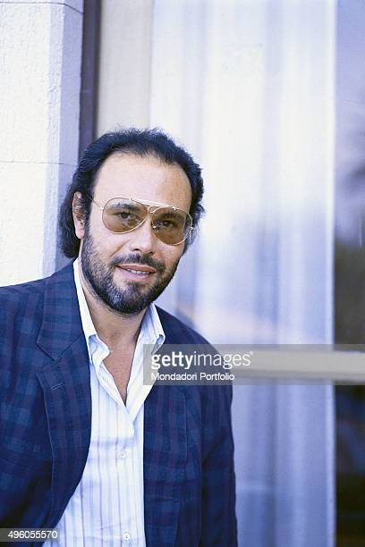 Portrait of the Italian songwriter Antonello Venditti posing in front of a big window Photo shoot Italy 1986