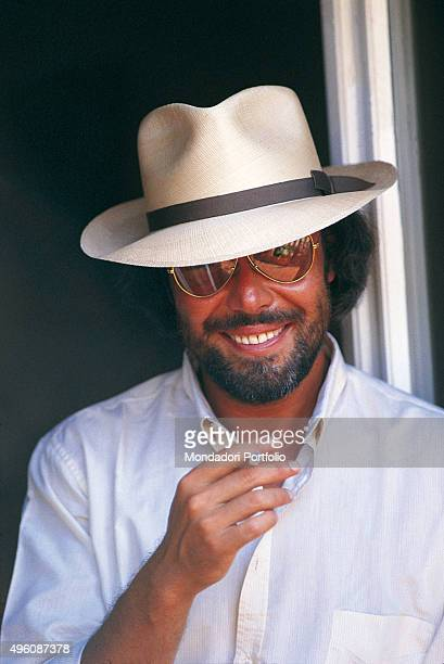 Portrait of the Italian songwriter Antonello Venditti with a hat and a cigarette in his hand during a photo shoot Italy 1985