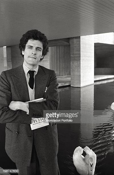 Portrait of the Italian writer Alain Elkann with his first novel Il Tuffo in his hand Segrate 1981