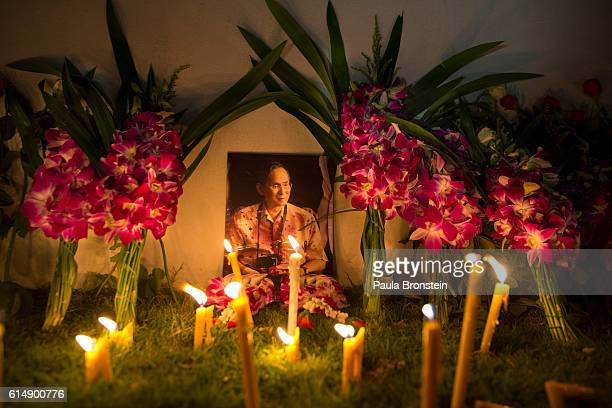 A portrait of the late King of Thailand is displayed outside the Grand Palace in the early hours of October 16 2016 in Bangkok Thailand The country...