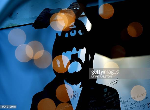 TOPSHOT A portrait of the late Motorhead singer/bassist Lemmy Kilmister during a memorial for the musician at the Rainbow Bar on the Sunset Strip in...