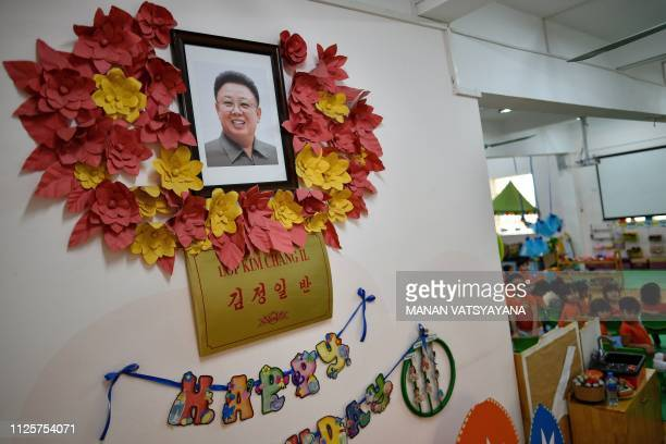 A portrait of the late North Korean leader Kim Jong Il decorates a classroom wall of the VietnamNorth Korea Friendship Kindergarten in Hanoi on...