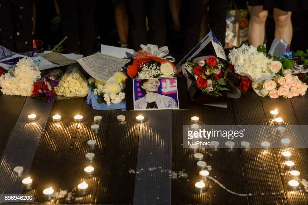 Portrait of the late of Kim JongHyun a 27yearold lead singer of the massively popular Kpop boyband SHINee is seen during a vigil held by Malaysian...