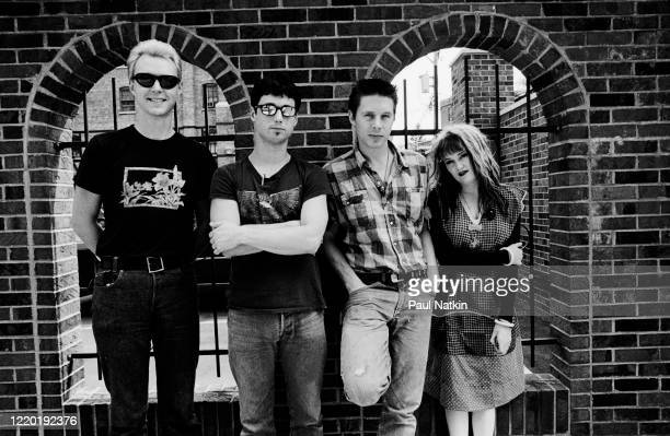 Portrait of the members of American Punk and Rock group X as they pose outisde a Days Inn hotel Chicago Illinois July 21 1982 Pictured are from left...