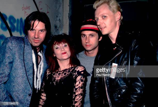 Portrait of the members of American Punk and Rock group X as they pose backstage at the Metro Chicago Illinois September 25 1985 Pictured are from...