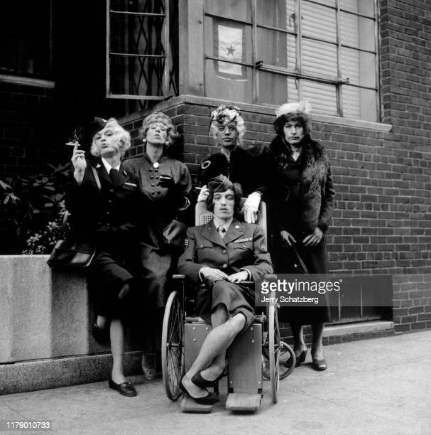 Portrait of the members of English Rock band the Rolling Stones dressed in wigs and women's clothing New York New York September 10 1966 The photo...