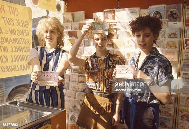 Portrait of the members of pop group Banarama as the pose in a shop, each holding a card with an astrological symbol, London, England, 1981. Pictured...