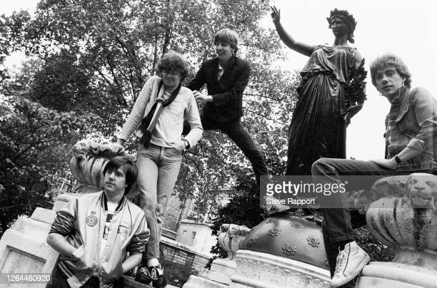 Portrait of the members of Rock group Stiff Little Fingers, Smithfield, London, 9/23/1982. Pictured are, from left, Henry Cluney, Jake Burns, Dolphin...