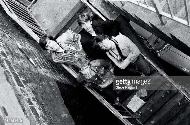 Portrait of the members of Rock group Stiff Little Fingers, Smithfield, London, 9/23/1982. Pictured are, fore, Ali McMordie and Jake Burns; rear,...