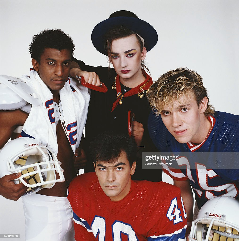 Portrait of the members of the British pop group Culture Club as they pose against a white background, New York, New York, 1983. Pictured are, from left, Mikey Craig, Boy George (top, in hat), John Moss (bottom, in red), and Roy Hay.