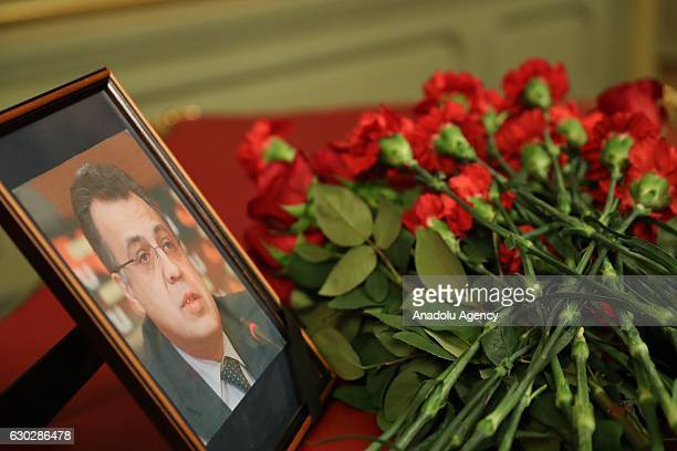 A portrait of the murdered Russian Ambassador to Turkey Andrei Karlov is seen with flowers in Moscow Russia on December 20 2016 The ambassador was...