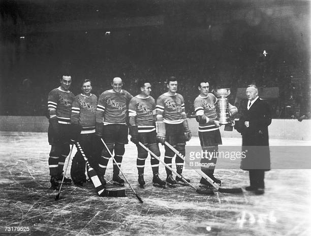 Portrait of the New York Rangers as they accept the Stanley Cup from National Hockey League President Frank Calder , Tornoto, Ontario, Canada, April...