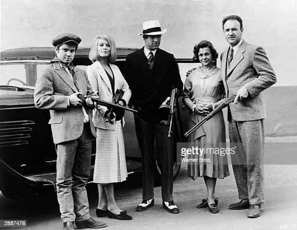 Portrait of the outlaw 'Barrow gang' holding their weapons from the film 'Bonnie And Clyde' directed by Robert Benton 1967 LR Michael J Pollard Faye...