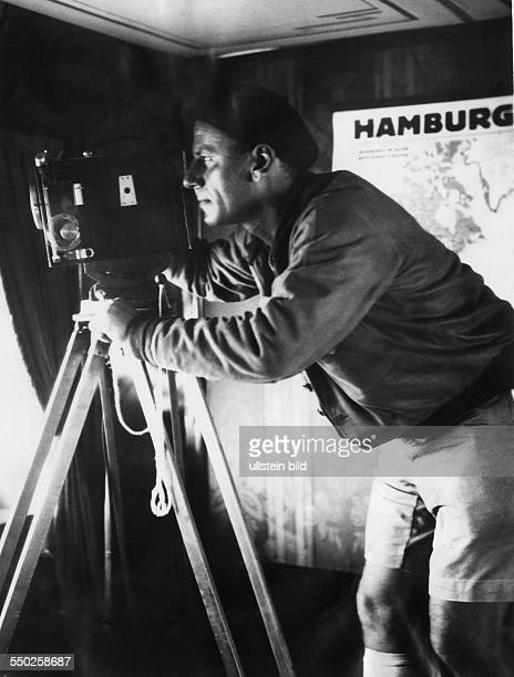 Portrait of the photographer at work during the trip aroundtheworld with the German aircraft carrier Graf Zeppelin Vintage property of ullstein bild