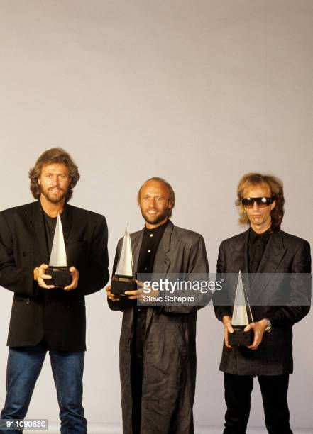 Portrait of the pop group the Bee Gees from left Barry Gibb Maurice Gibb and Robin Gibb as they pose each one with an American Music Awards in their...