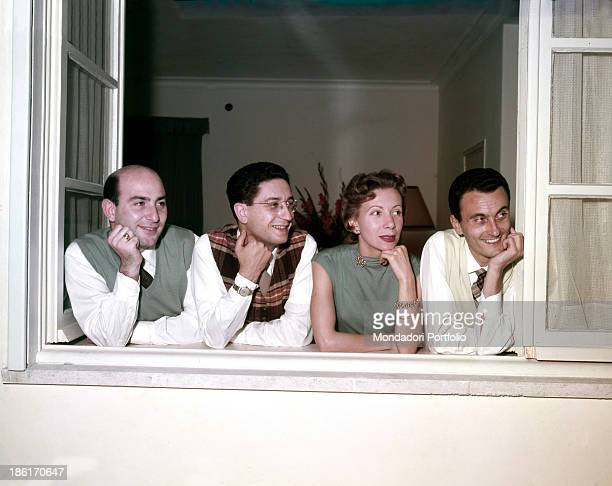 Portrait of the Quartetto Cetra by the window The band is formed by Italian singer and drummer Felice Chiusano Italian singer and actor Tata...