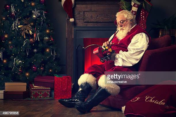 Portrait of the Real Santa Claus at home painting toys