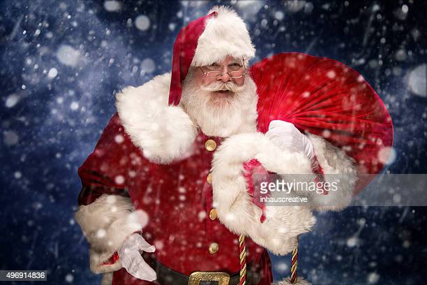 Portrait of the Real Santa Claus carrying gift sack