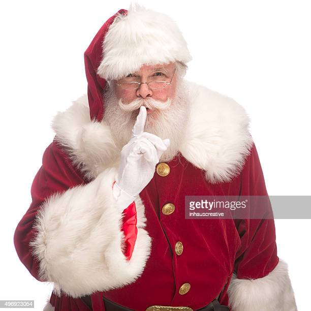 Portrait of the Real Santa Claus with fingers on lips
