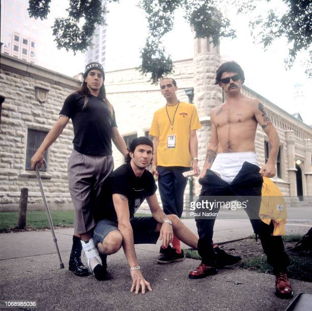 Portrait of the Red Hot Chili Peppers, left to right, Anthony Kiedis, Chad Smith, John Frusciante, and Flea on the street in Chicago, Illinois,...