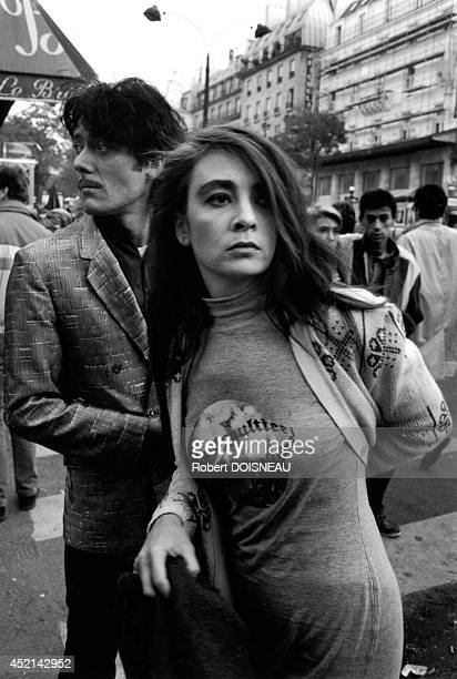Portrait of the rock band 'Les Rita Mitsouko' walking in the street on November 16 1988 in Paris France
