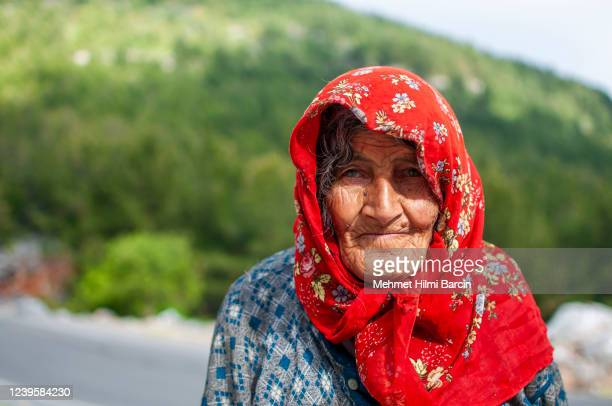portrait of the senior muslim shepherd - headscarf stock pictures, royalty-free photos & images