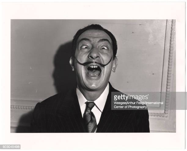 Portrait of the Spanish surrealist painter and sculptor Salvador Dali as he makes a comic face New York New York 1940s or 1950s Photo by Weegee...