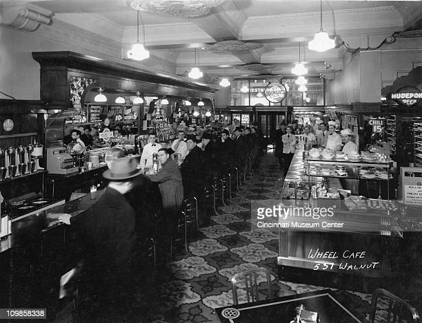 Portrait of the staff and customers of the Wheel Café , Cincinnati, Ohio, late 1930s.