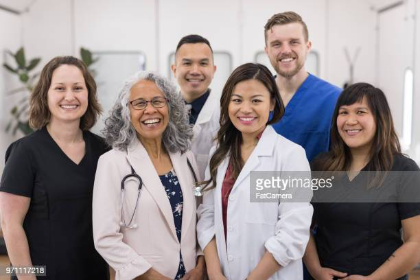 portrait of the staff at a doctor's office - group of doctors stock pictures, royalty-free photos & images