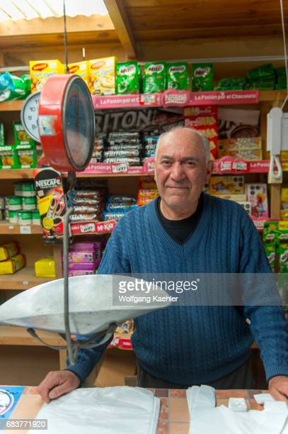 Portrait of the store owner in a small convenient store in the village of Pargua in the Lake District of Chile