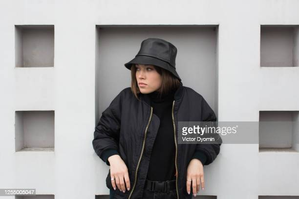 portrait of the stylish girl in black panama - herbst winter kollektion stock-fotos und bilder
