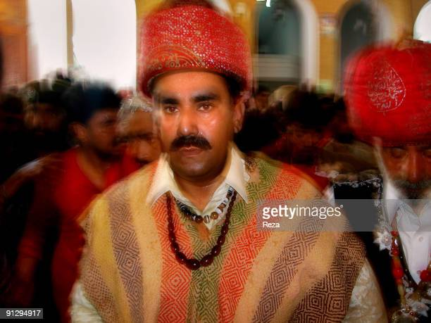 Portrait of the sufi master Sheikh Akhtar Hussein Pirzada titled as Noor Ali Shah wearing his traditional dress known as Dastar while he pays visit...