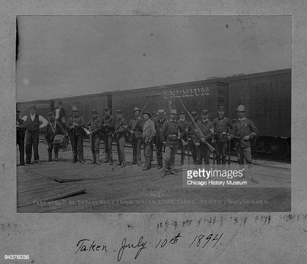 Portrait of the troops and soldiers of Company D prior to boarding the first meat train sent during the Pullman strike Chicago IL July 1894